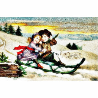 A christmas greeting with a guy and girl snow slad acrylic cut out