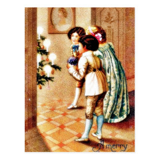 A christmas, three girls looking at the decorated post card