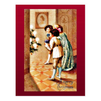 A christmas, three girls looking at the decorated postcard