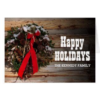 A Christmas wreath on a cabin wall Card