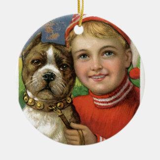 A chubby boy and a dog posing ceramic ornament