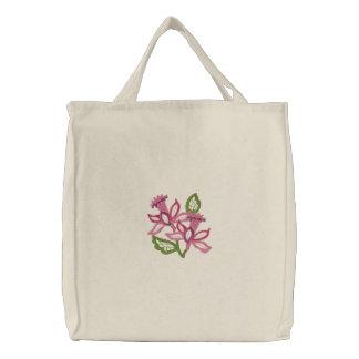 A cielo abierto floral bolsas de mano bordadas