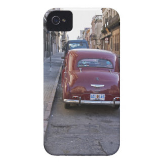 A classic old red Peugeot car parked on a street iPhone 4 Covers