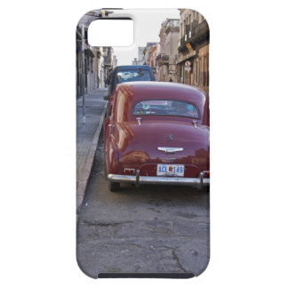 A classic old red Peugeot car parked on a street iPhone 5 Covers