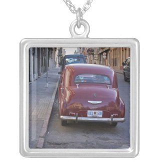 A classic old red Peugeot car parked on a street Square Pendant Necklace