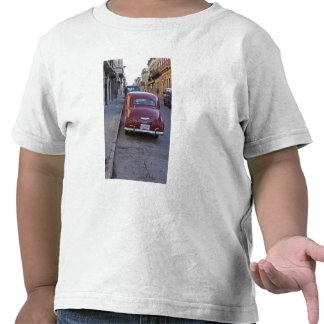 A classic old red Peugeot car parked on a street Tee Shirts