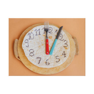 a clock made of piadina wrapped canvas print