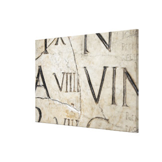 A close-up of ancient Roman letters on marble. Canvas Print