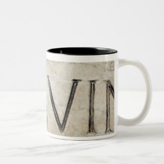 A close-up of ancient Roman letters on marble. Coffee Mugs