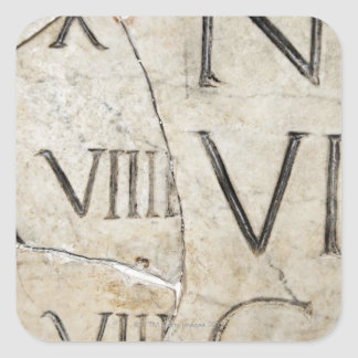 A close-up of ancient Roman letters on marble. Square Sticker