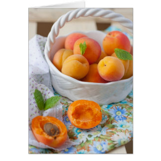 A closeup of apricots in a bowl cards