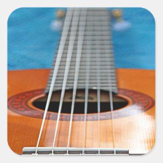 A Closeup of Guitar Strings Square Sticker