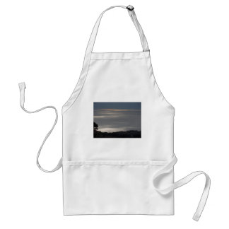 A cloudy sea and a setting sun adult apron