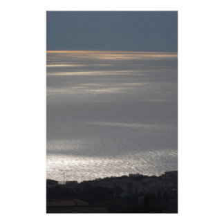 A cloudy sea and a setting sun stationery