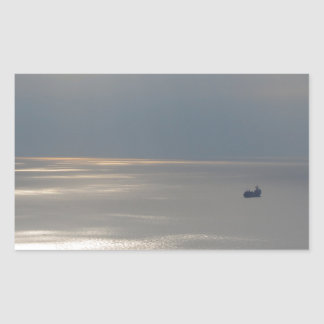 A cloudy sea and a setting sun rectangular stickers