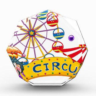 A clown with a circus signage and a ferris wheel a award