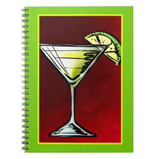 A Cocktail Drink in a Martini Glass with Lime Notebook
