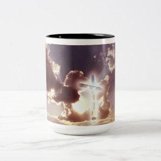A coffee mug with a cross in the sky