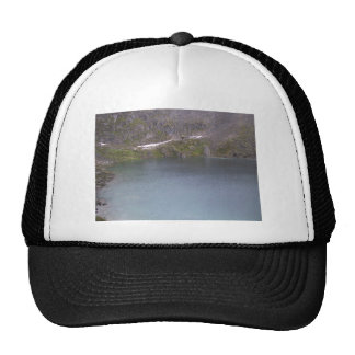 A Cold Mountain Lake In Alaska On An Overcast Day Trucker Hats