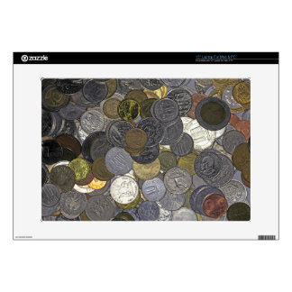 A collection of old and international coins skins for laptops