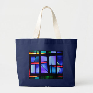 A colorful collage large tote bag