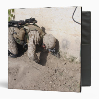 A combat engineer searches for weapons caches binder