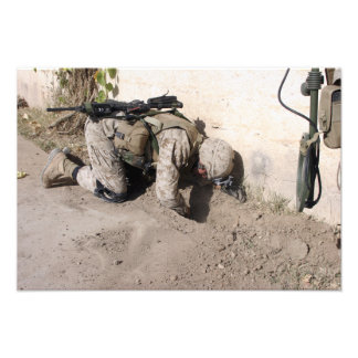 A combat engineer searches for weapons caches photo print