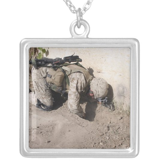 A combat engineer searches for weapons caches silver plated necklace