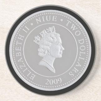 A commemorative silver coin sandstone coaster