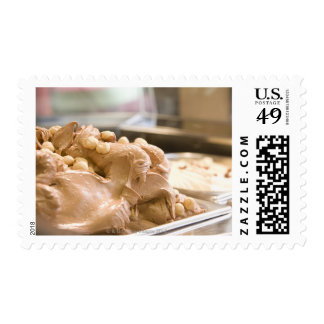 A container full of hazelnut ice cream postage