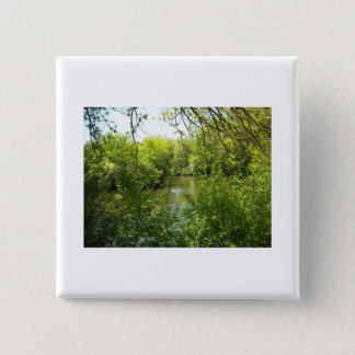 A cottage tucked away pinback button