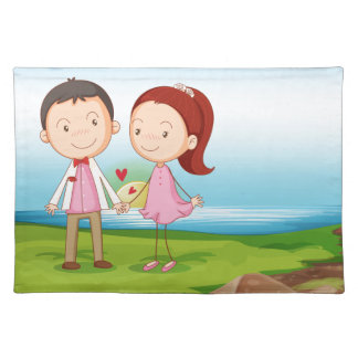 A couple at the riverbank near the rocks cloth placemat