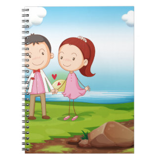 A couple at the riverbank near the rocks spiral notebook