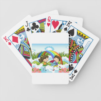 A couple dating near the rainbow bicycle playing cards