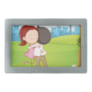 A couple hugging each other near the tree rectangular belt buckle