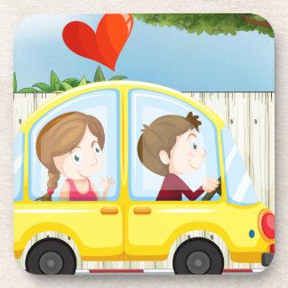 A couple inside the yellow car coaster