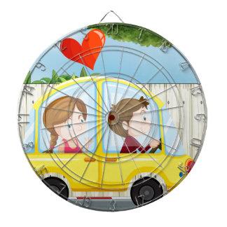 A couple inside the yellow car dartboard