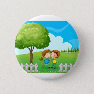 A couple near the tree button
