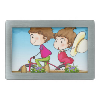 A couple riding a bicycle rectangular belt buckle