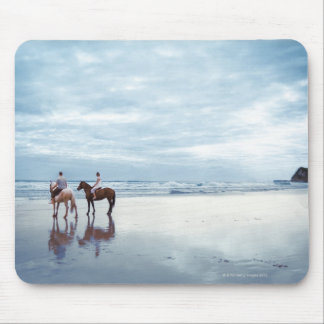 A couple riding horses on Parkiri beach in New Mouse Pad