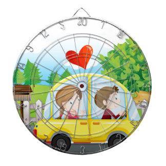 A couple riding on a yellow car dartboard