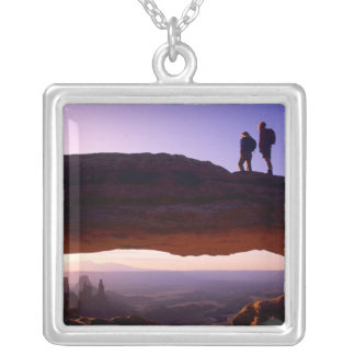 A couple watches sunrise from atop Mesa Arch in Custom Necklace