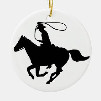 A cowboy riding with a lasso. ceramic ornament