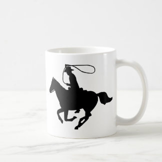 A cowboy riding with a lasso. classic white coffee mug