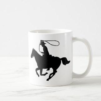 A cowboy riding with a lasso. coffee mug