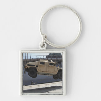 A crane lifts an M998 Humvee Silver-Colored Square Keychain