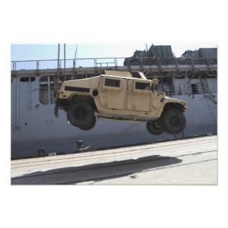 A crane lifts an M998 Humvee Photo Art