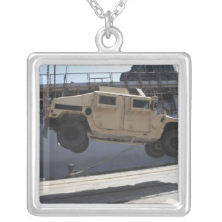 A crane lifts an M998 Humvee Silver Plated Necklace