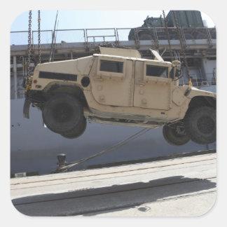 A crane lifts an M998 Humvee Square Sticker