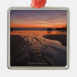 A crescent moon sets through a dusk-colored sky square metal christmas ornament